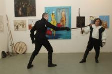 На вернисаже биеннале клуб «Парад-Рипост» -фехтмейстер Руслан Каприлов и Виталий Фёдоров, представляют «От двуручного меча до легкой шпаги» - демонстрация приемов владения историческим холодным оружием