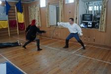 Фехтуют Ольга Николаева и Руслан Каприлов